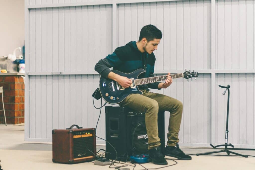 How To Hold An Electric Guitar Properly: A Pro's #1 Tips